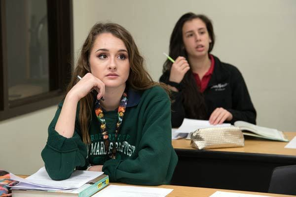 photo of 2 students sitting in class