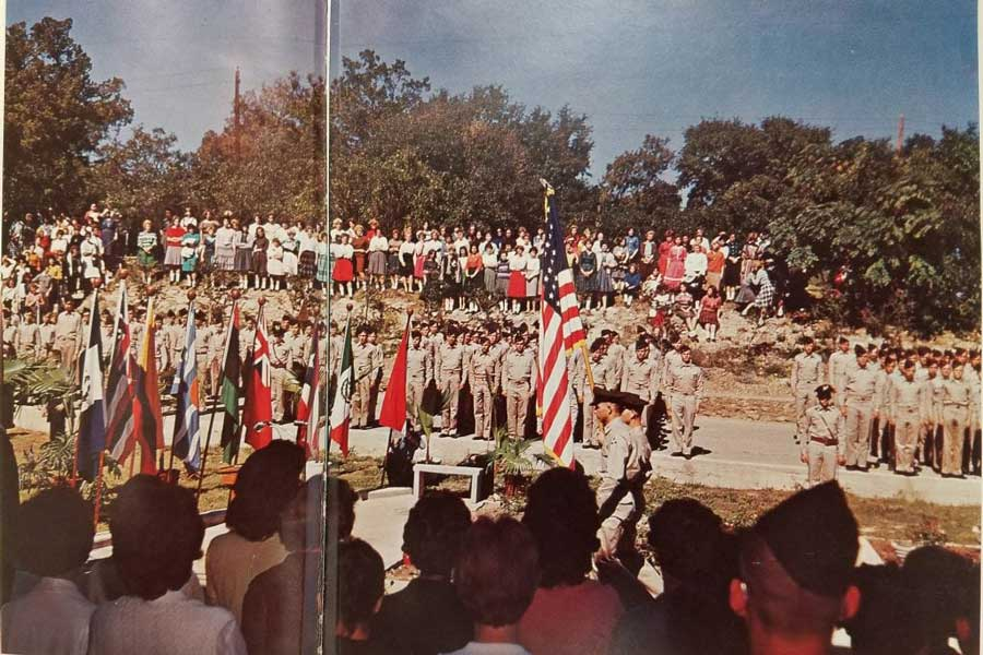 Students pay respects at the Dedication of the Garden of Flags at SMA in 1961.