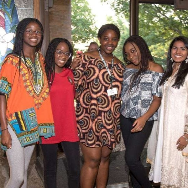Students display colorfully patterned outfits at the culture fair.