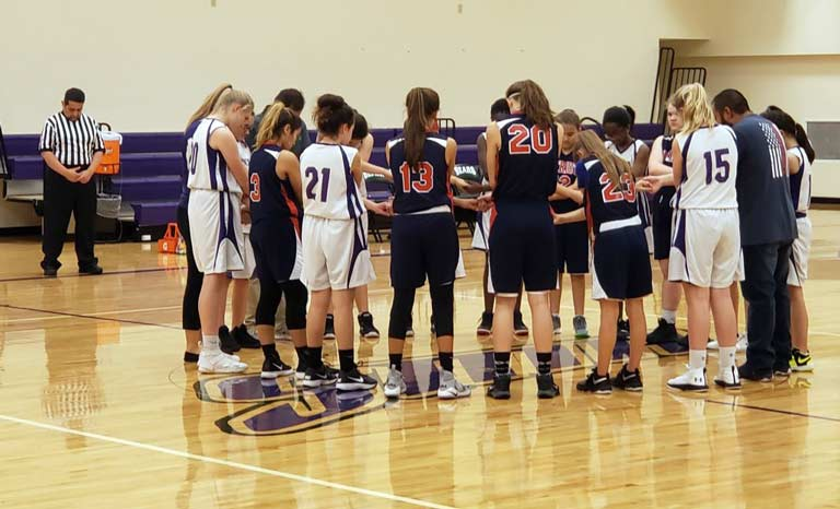 The girls' basketball team prepares before a game.