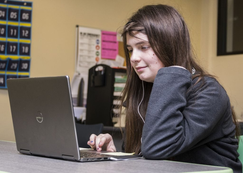 Student does homework with audiobooks