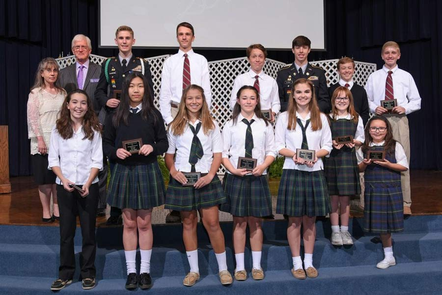 The class of 2002 receives their awards at the End-of-Year Academy Awards Program.