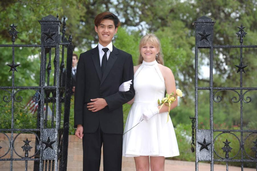 Two students walk through the Senior Gate at the Rose and Sabre ceremony.