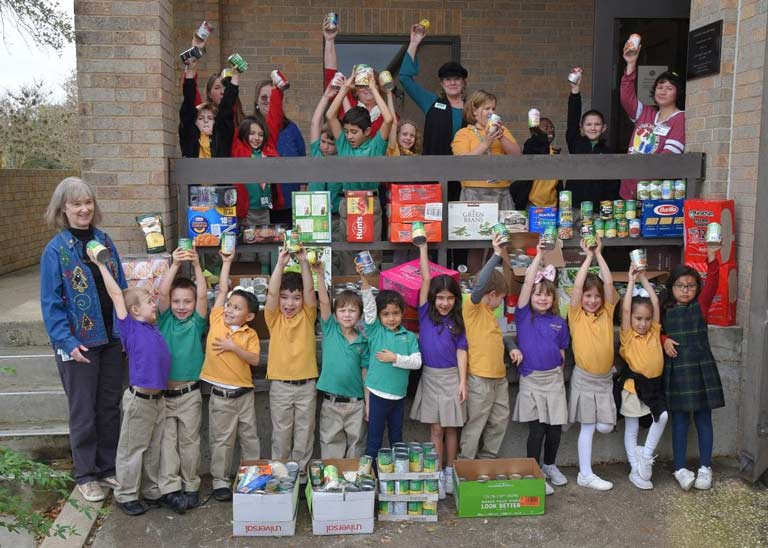 The lower school holds their canned food drive at Davidson Hall.