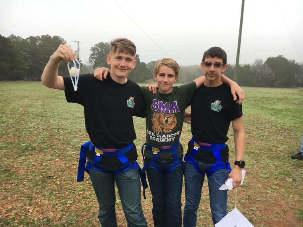 Students wearing harnesses