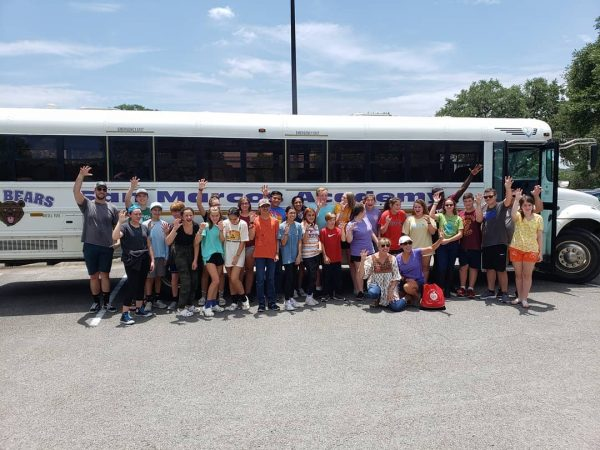 Students arriving at the Highland Lakes Journey Camp by bus