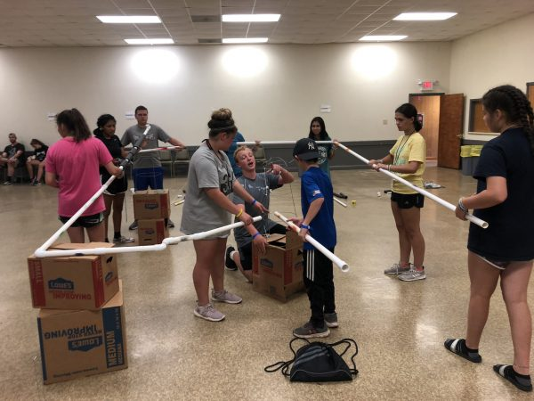 Students working together to build a project using pvc pipes