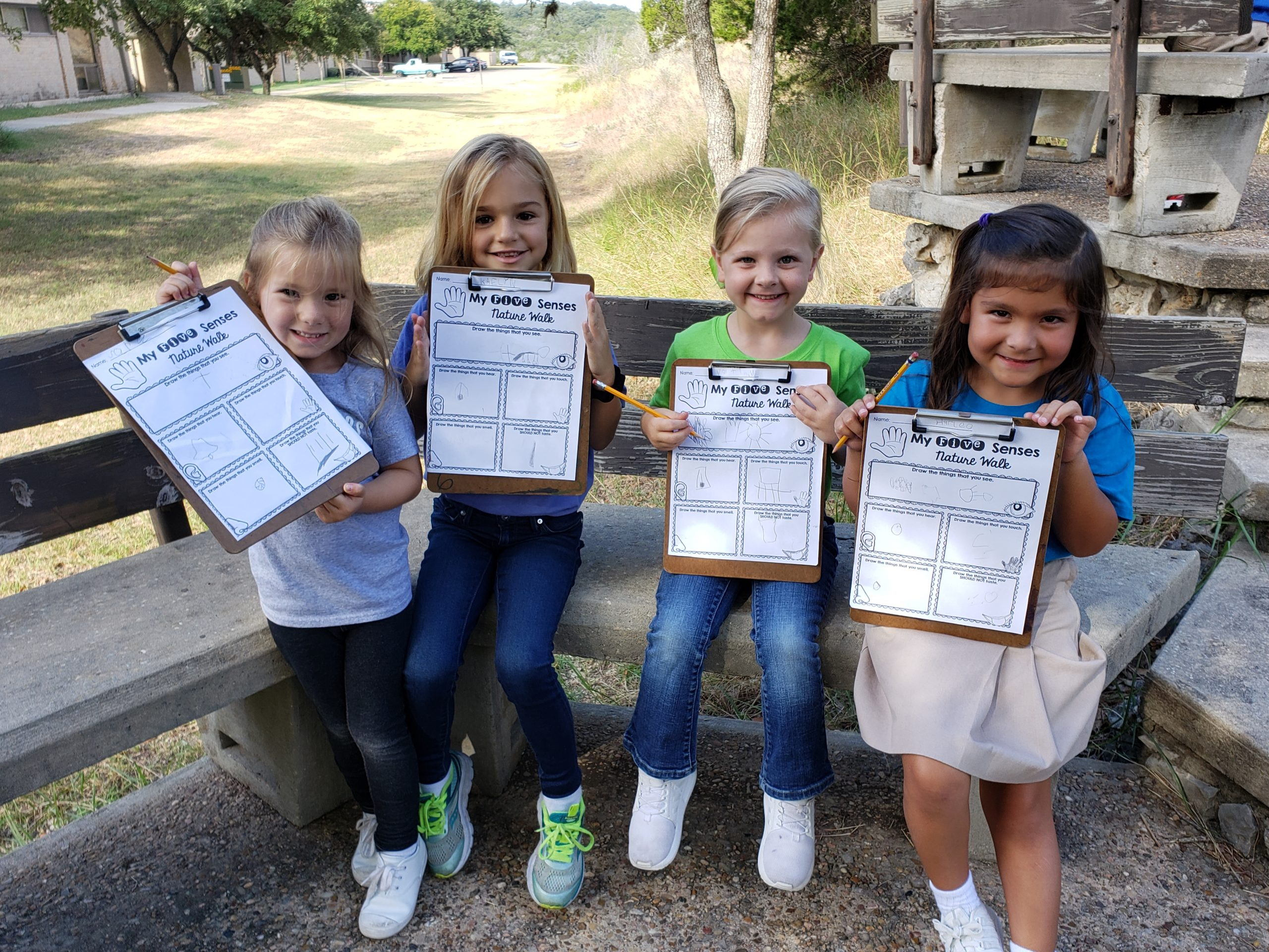 Lower School students showing off what they learned after a nature walk