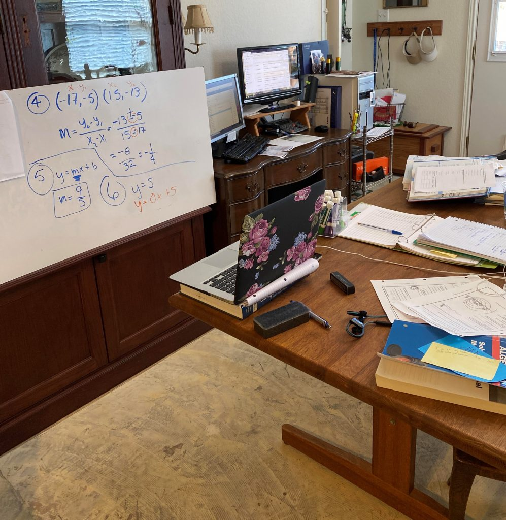 Belle Howell's kitchen workspace includes a dry erase board she can broadcast using her laptop's webcam.