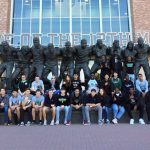 "Seniors touring Texas A&M and posing near the ""Home of the 12th Man"" statue"