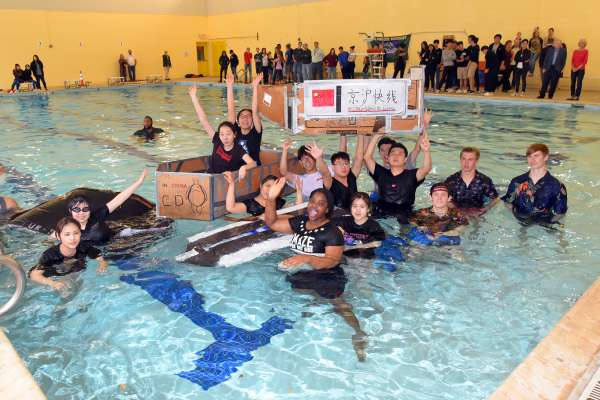 Students celebrate after an event in the indoor pool