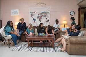 Girls socializing in a dorm common area at our boarding school in Texas