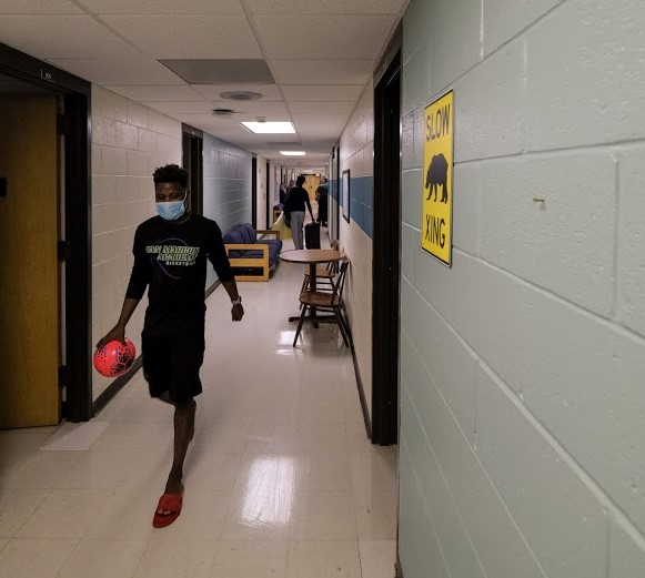 Students walking through the halls of a dormitory